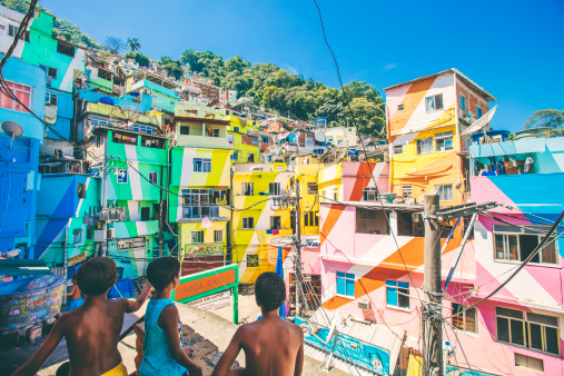 166602887-boys-playing-with-kites-in-favela-gettyimages.jpg